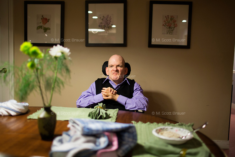 Frank Bandolfh, 56, sits at a table for dinner at an assisted living home run by Northeast Residential Services in Bedford, Massachusetts, USA.  The residents previously lived at the Fernald Developmental Center in Waltham, Massachusetts, USA.