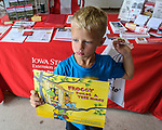 Titus Upp of Truro got a free book from ISU Extension booth during the Warren County Fair. Extension offered free books to children.