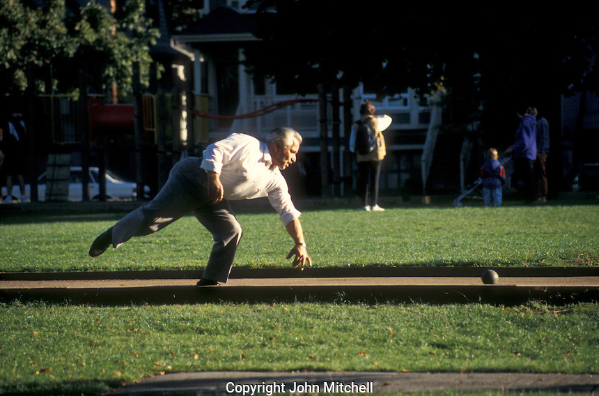 Italian immigrant playing Bocce Ball in a park in the Little Italy district near Commercial Drive, Vancouver, British Columbia, Canada