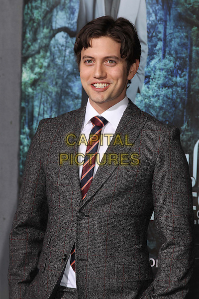 "Jackson Rathbone.""Beautiful Creatures"" Los Angeles Premiere held at the TCL Chinese Theatre, Hollywood, California, USA. .February 6th, 2013.half length suit grey gray red stripe tie blue.CAP/CEL .©CelPh/Capital Pictures."