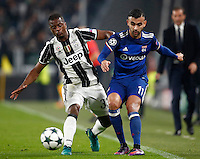 Calcio, Champions League: Gruppo H, Juventus vs Lione. Torino, Juventus Stadium, 2 novembre 2016. <br /> Juventus&rsquo; Patrice Evra, left, is challenged by Lyon's Rachid Ghezzal during the Champions League Group H football match between Juventus and Lyon at Turin's Juventus Stadium, 2 November 2016. The game ended 1-1.<br /> UPDATE IMAGES PRESS/Isabella Bonotto