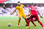 Massimo Luongo of Australia (L) is tackled by players of Jordan during the AFC Asian Cup UAE 2019 Group B match between Australia (AUS) and Jordan (JOR) at Hazza Bin Zayed Stadium on 06 January 2019 in Al Ain, United Arab Emirates. Photo by Marcio Rodrigo Machado / Power Sport Images