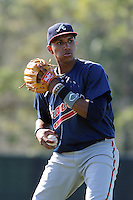 Infielder Johan Camargo (33) of the Atlanta Braves farm system in a Minor League Spring Training workout on Tuesday, March 17, 2015, at the ESPN Wide World of Sports Complex in Lake Buena Vista, Florida. (Tom Priddy/Four Seam Images)
