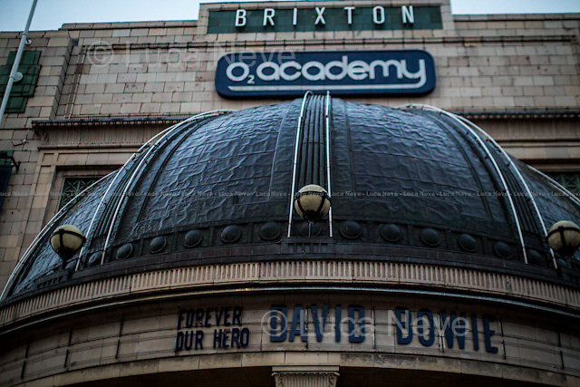 Brixton, The Brixton Academy (officially called O2 Academy). <br /> <br /> London, 11/01/2016. Today, David Bowie has died at the age of 69. During the day London's people gathered in Brixton (At Jimmy C graffiti, outside the house at 40 Stansfield Road where he was born, and for the street party outside the Ritzy Cinema) and outside 23 Heddon Street (Where a plaque commemorates Ziggy Stardust) to leave a flower, a message, an album, a candle, a letter; tokens to remember and commemorate a Londoner, an icon and a legend of the world music. David Bowie, real name David Robert Jones (8 January 1947 &ndash; 10 January 2016), was born in Brixton. He was an English singer, songwriter, multi-instrumentalist, record producer, arranger, painter and actor. He died 18 months after being diagnosed with cancer. On the 8th of January, day of his 69th birthday, David Bowie released his 27th and last album: &quot;Blackstar&quot;.<br /> <br /> For more information please click here: http://www.davidbowie.com/