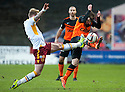 Motherwell's Craig Reid goes in high on Dundee Utd's Aidan Connolly.