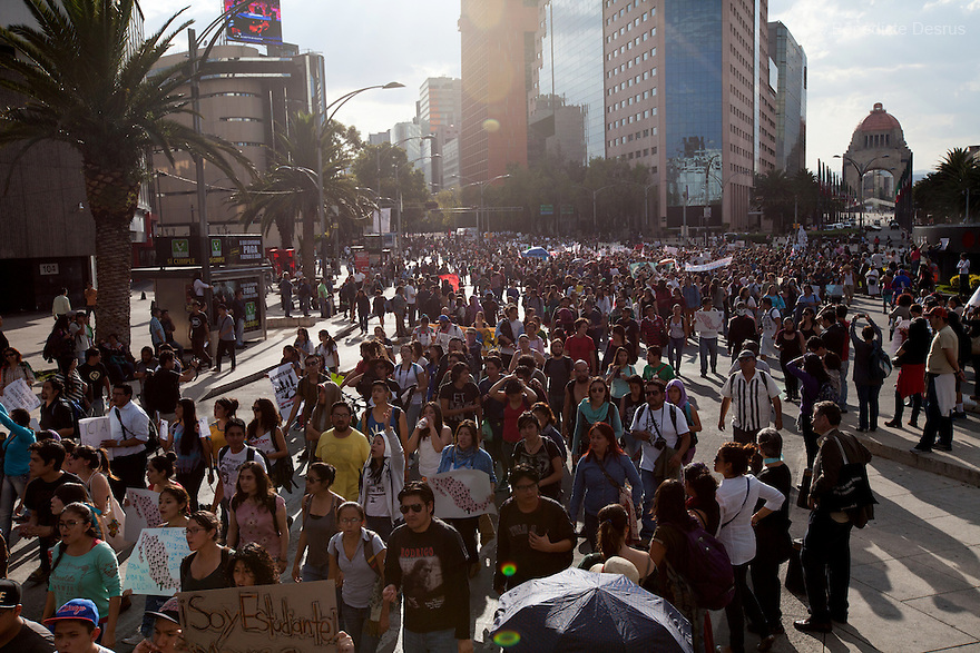 Thousands protesters march to demand justice for the disappearance of 43 students in the state of Guerrero, in Mexico City, Mexico on October 8, 2014.<br /> Mexico&rsquo;s federal forces took over security in the city of Iguala, state of Guerrero, and began searching for 43 college students that went missing&nbsp;after violent confrontations during a political protest that took place on Sept. 26 and left six people dead, 25 wounded and 43 missing. The federal officers arrived after the discovery of a mass grave containing 28 unidentified bodies outside Iguala, amid suspicion that local police conspired with an area drug gang &ldquo;Guerreros Unidos&rdquo; to massacre dozens of students. DNA testing to confirm the identities of the remains is expected to take weeks. (Photo by B&eacute;n&eacute;dicte&nbsp;Desrus)