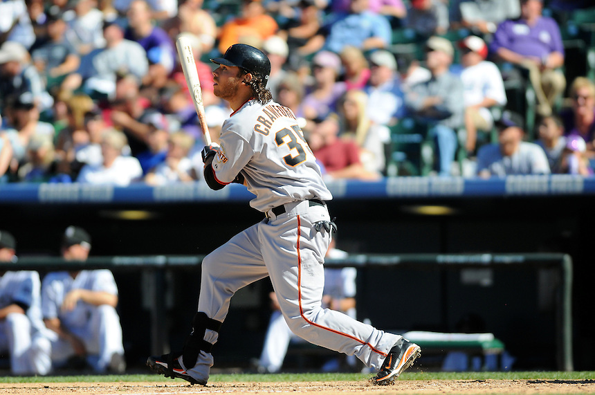 18 SEPTEMBER 2011:    Giants shortstop Brandon Crawford (35) hits the third homerun of his MLB career  during a regular season game between the San Francisco Giants and the Colorado Rockies at Coors Field in Denver, Colorado. The Giants beat the Rockies 12-5. *****For Editorial Use Only*****