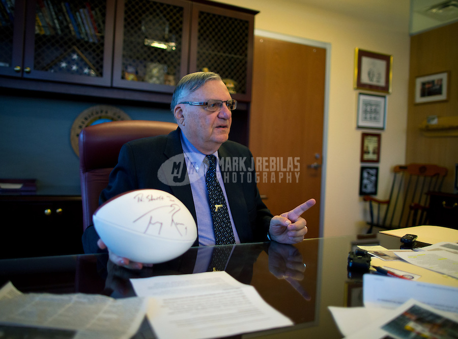 Jan 21, 2015; Phoenix, AZ, USA; Maricopa County sheriff Joe Arpaio with an NFL football autographed by Dallas Cowboys quarterback Tono Romo in his office in downtown Phoenix. Mandatory Credit: Mark J. Rebilas-