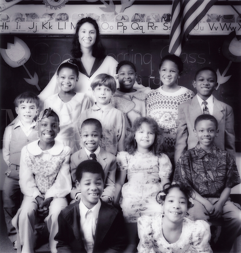 Elementary school class portrait with multi-ethnic students.
