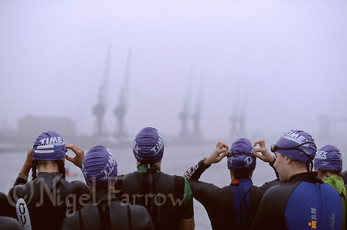20 SEP 1998 - LONDON, UK - Age group women wait for the fog to clear so their race can start at the London Triathlon. (PHOTO (C) NIGEL FARROW)