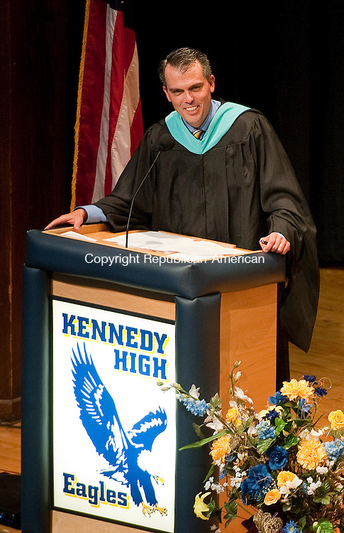 WATERBURY, CT 24 JUNE 2013--062413JS09- Kennedy High School first year principal Robert Johnston addresses the students  during graduation ceremonies Monday at Kennedy High School in Waterbury. <br /> Jim Shannon Republican American