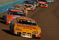 Nov 13, 2005; Phoenix, Ariz, USA;  Nascar Nextel Cup driver Travis Kvapil driver of the #77 Kodak Dodge leads a pack of cars during the Checker Auto Parts 500 at Phoenix International Raceway. Mandatory Credit: Photo By Mark J. Rebilas