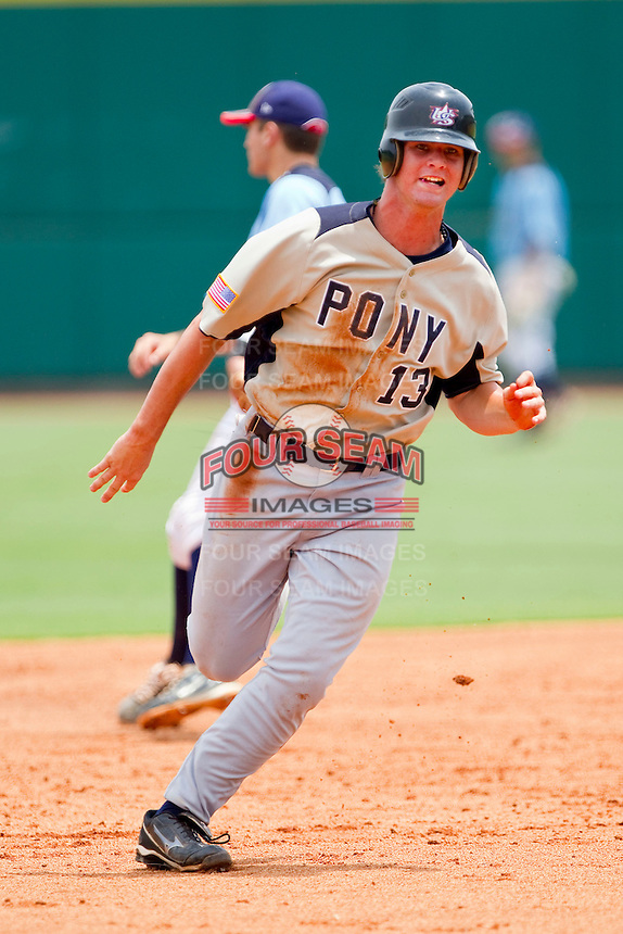 Jesse Winker #13 of PONY hustles towards third base against Dixie at the 2011 Tournament of Stars at the USA Baseball National Training Center on June 26, 2011 in Cary, North Carolina.  PONY defeated Dixie 4-3. (Brian Westerholt/Four Seam Images)