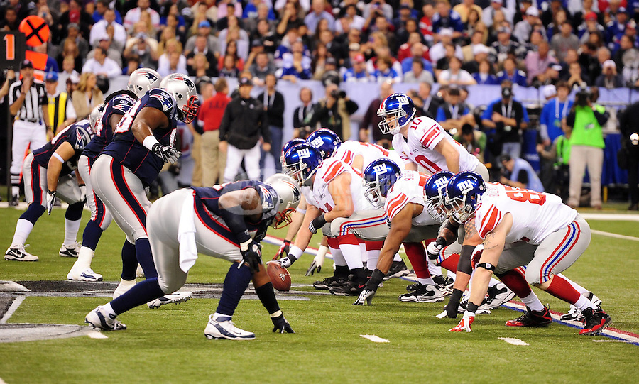 Feb 5, 2012; Indianapolis, IN, USA; New York Giants quarterback Eli Manning (10) under center at the line of scrimmage during the first half of Super Bowl XLVI against the New England Patriots at Lucas Oil Stadium.  Mandatory Credit: Mark J. Rebilas-