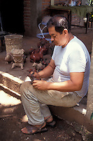 Artisan making replicas of pre-Hispanic figurines in the city of Colima, Mexico