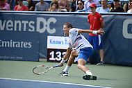 Washington, DC - August 3, 2014: Vasek Pospisil of Canada stretches to return the ball in the Citi Open final at the Fitzgerald Tennis Center, August 3, 2014. Fellow Canadian Milos Raonic won in straight sets over Pospisil.   (Photo by Don Baxter/Media Images International)