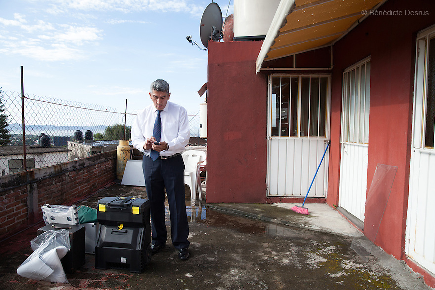 "Donovan arrives at the scene of an unsolved homicide in Cuernavaca, Morelos – one of Mexico's most dangerous cities on August 7, 2015. The 66-year-old victim was a retired economics lecturer from the local university, and was killed in January of this year. The cleanup took place eight months later. The victim's family has since moved away to avoid further trouble. They remarked that justice is slow in Mexico and expressed dissatisfaction with the police investigation, but appreciated Donovan's discretion and professionalism. Donovan Tavera, 43, is the director of ""Limpieza Forense México"", the country's first and so far the only government-accredited forensic cleaning company. Since 2000, Tavera, a self-taught forensic technician, and his family have offered services to clean up homicides, unattended death, suicides, the homes of compulsive hoarders and houses destroyed by fire or flooding. Despite rising violence that has left 70,000 people dead and 23,000 disappeared since 2006, Mexico has only one certified forensic cleaner. As a consequence, the biological hazards associated with crime scenes are going unchecked all around the country. Photo by Bénédicte Desrus"