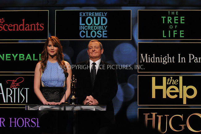WWW.ACEPIXS.COM . . . . .  ....January 24 2012, LA....Actress Jennifer Lawrence (L) and Academy of Motion Picture Arts and Sciences President Tom Sherak announce the 84th Academy Awards nominations at the Academy of Motion Picture Arts and Sciences Samuel Goldwyn Theater on January 24, 2012 in Los Angeles, California.....Please byline: PETER WEST - ACE PICTURES.... *** ***..Ace Pictures, Inc:  ..Philip Vaughan (212) 243-8787 or (646) 679 0430..e-mail: info@acepixs.com..web: http://www.acepixs.com