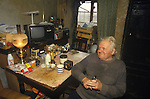 Great Tew Oxfordshire 1980s. Local resident Frank Salt who lives n the Toll House.