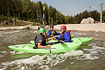 April 30, 2012. Charlotte, NC.. Erik Weihenmayer, right, regroups with Pablo McCandless, a former Olympic kayaker, left, and Rob Raker after going through a rapid.. Erik Weihenmayer, who has been completely blind since age 13, is training at the United States National White Water Center in an attempt to kayak through the Grand Canyon. Weihenmayer is an accomplished outdoorsman who has climbed the 7 Summits, and is the only blind person to climb Mount Everest.