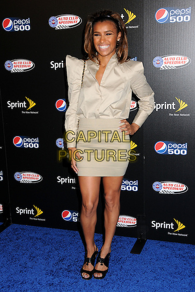 MELODY THORNTON - PUSSYCAT DOLLS.Auto Club Speedway Celebrates the Pepsi 500 Hosted by Jeff Gordon held at the Roosevelt Hotel, Hollywood, California, USA..October 7th, 2009.full length beige grey gray skirt shoulder pads skirt hand on hip blouse shirt .CAP/ADM/BP.©Byron Purvis/AdMedia/Capital Pictures.