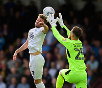 Peterborough United's Matthew Godden vies for possession with Scunthorpe United's Jak Alnwick<br /> <br /> Photographer Chris Vaughan/CameraSport<br /> <br /> The EFL Sky Bet League One - Scunthorpe United v Peterborough United - Saturday 13th October 2018 - Glanford Park - Scunthorpe<br /> <br /> World Copyright &copy; 2018 CameraSport. All rights reserved. 43 Linden Ave. Countesthorpe. Leicester. England. LE8 5PG - Tel: +44 (0) 116 277 4147 - admin@camerasport.com - www.camerasport.com