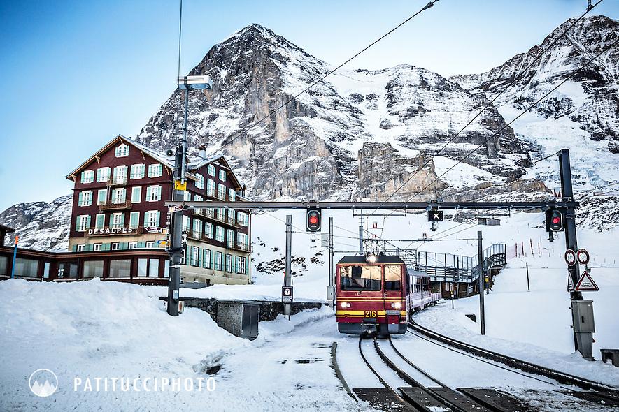 The Jungfraujoch train comes into Kleine Scheidegg on a cold winter morning beneath the Eiger Nordwand, Switzerland