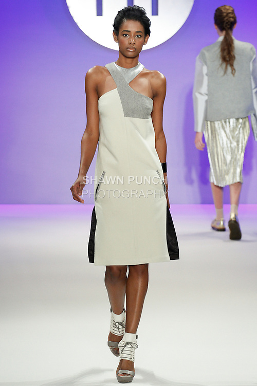 Model walks runway in an outfit by Sylvia Rodriguez, during the FIT Future of Fashion 2014 Graduates' Collection fashion show, at the Fashion Institute of Technology on May 1, 2014.