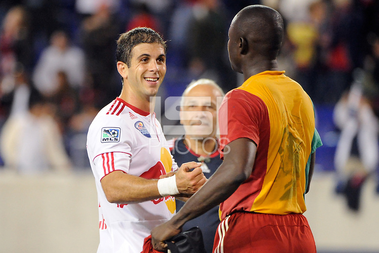 Carlos Mendes (44) of the New York Red Bulls celebrates with goalkeeper Bouna Coundoul (18) after the match. The New York Red Bulls defeated the Kansas City Wizards 1-0 during a Major League Soccer (MLS) match at Red Bull Arena in Harrison, NJ, on October 02, 2010.