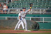 Burlington Bees first baseman Connor Fitzsimons (4) stretches for a throw during a Midwest League game against the Lansing Lugnuts on July 18, 2019 at Cooley Law School Stadium in Lansing, Michigan.  Lansing defeated Burlington 5-4.  (Mike Janes/Four Seam Images)