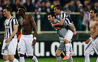 Calcio, ritorno degli ottavi di finale di Europa League: Fiorentina vs Juventus. Firenze, stadio Artemio Franchi, 20 marzo 2014. <br /> From left, Juventus Stephan Lichsteiner, Paul Pogba, Gianluigi Buffon, Carlos Tevez and Martin Caceres celebrate at the end of the Europa League round of 16 second leg football match between Fiorentina and Juventus at Florence's Artemio Franchi stadium, 20 March 2014. Juventus won 1-0 to advance to the quarter-finals.<br /> UPDATE IMAGES PRESS/Isabella Bonotto