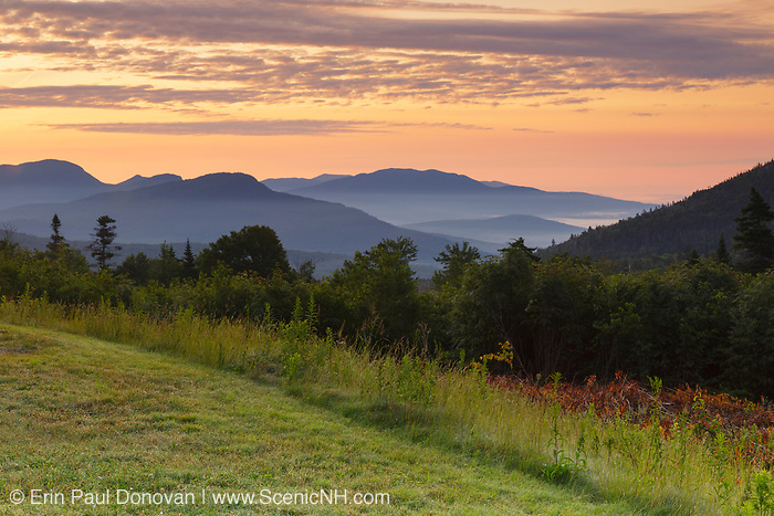 Sunrise over the White Mountains from the C.L. Graham Wangan Grounds Scenic Overlook along the Kancamagus Highway (route 112) in the White Mountains, New Hampshire USA during the summer months. The Kancamagus Highway is one of New England's scenic byways.
