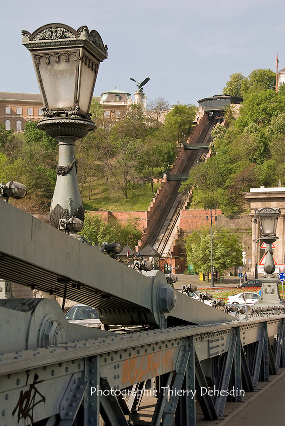 Central Europe, Hungary, Budapest 2007/04: The Széchenyi Chain Bridge. .It is a suspension bridge that spans the River Danube between Buda and Pest down the Buda Royal castle. Its decorations are made of cast iron. The Castle Hill Funicular and the Buda Royal Castle in the background.