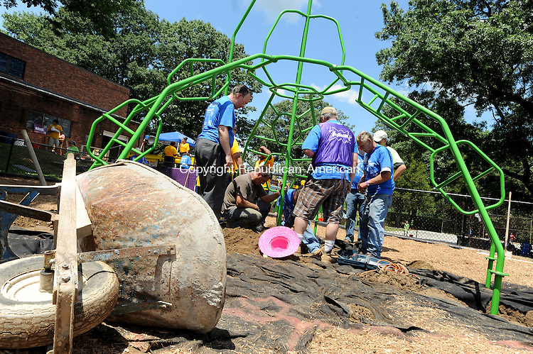 WATERBURY, CT-23 JUNE 2012--062312JS16-Volunteers work on installing a piece of playground equiptment while hundreds of volunteers build a new playground at Chase Park on Saturday. The park was based on design drawings created by children. . Jim Shannon Republican-American