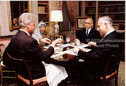 Washington, DC - (FILE) -- United States President Bill Clinton hosts a luncheon for Middle East Peace on October 1, 1996. From left to right:  President Clinton; Palestinian Authority Chairman Yassir Arafat; King Hussein of Jordan; Prime Minister Binyamin Netanyahu of Israel..Mandatory Credit: Sharon Farmer - White House via CNP.