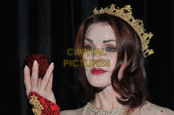 Priscilla Presley.Press launch to star in New Wimbledon Theatre's annual pantomime offering 'Snow White and the Seven Dwarfs' at The Savoy, Strand, London, England..September 26th, 2012.panto costume headshot portrait hand apple gold red crown sequins sequined  .CAP/BF.©Bob Fidgeon/Capital Pictures.