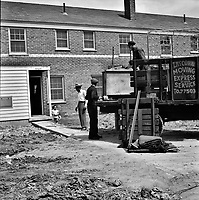 First Black family moving into the Sojourner Truth neighborhood, Detroit, Michigan, 1942<br /> <br /> Photo by Arthur S. Siegel.