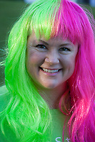 Woman wearing pink and green wig, Seattle Center, WA, USA.