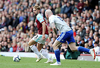 Burnley's Charlie Taylor under pressure from Cardiff City's Aron Gunnarsson<br /> <br /> Photographer Rich Linley/CameraSport<br /> <br /> The Premier League - Saturday 13th April 2019 - Burnley v Cardiff City - Turf Moor - Burnley<br /> <br /> World Copyright © 2019 CameraSport. All rights reserved. 43 Linden Ave. Countesthorpe. Leicester. England. LE8 5PG - Tel: +44 (0) 116 277 4147 - admin@camerasport.com - www.camerasport.com