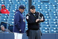 GREENSBORO, NC - FEBRUARY 25: UNC Greensboro head coach Billy Godwin discusses a pitching change with home plate umpire Brett Dickerson during a game between Fairfield and UNC Greensboro at UNCG Baseball Stadium on February 25, 2020 in Greensboro, North Carolina.