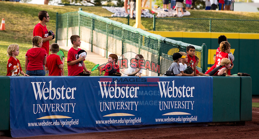 A group of young fans stand for the National Anthem prior to a game between the Arkansas Travelers and the Springfield Cardinals at Hammons Field on July 25, 2012 in Springfield, Missouri. (David Welker/Four Seam Images)
