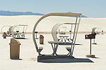 Picnic shelters with tables and grills in the glaring white dunes