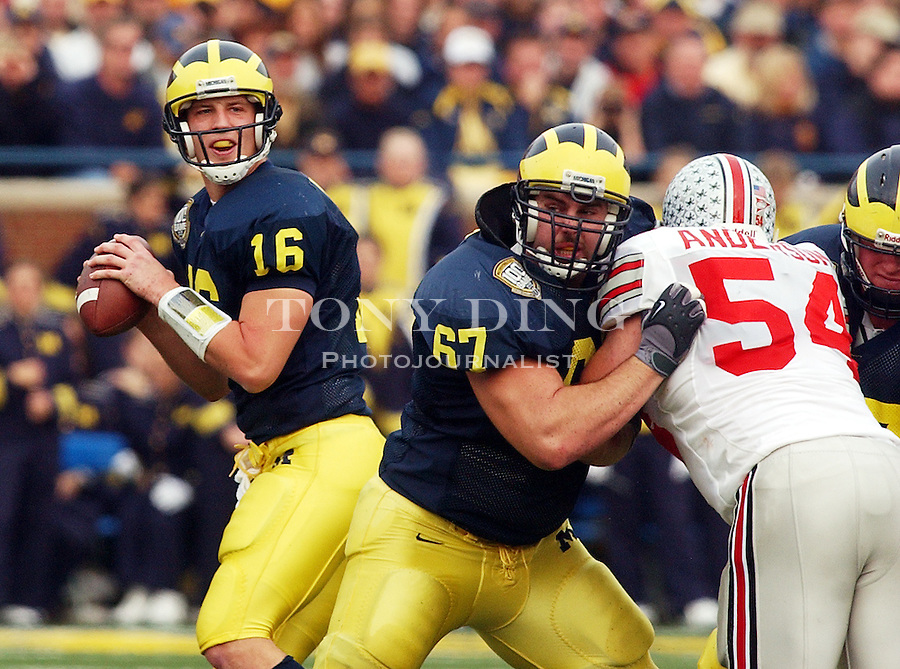 Michigan senior quarterback John Navarre (16) during the Wolverine's 35-21 upset of Ohio State on Saturday, November 22, 2003 in Ann Arbor, Mich. This was the 100th rivary match between UM and OSU. (TONY DING/The Michigan Daily)