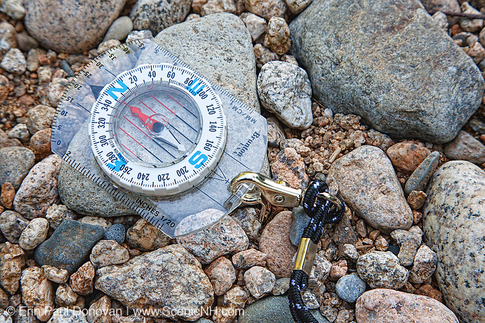 Compass on rocks in the White Mountains, New Hampshire USA