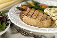 boneless porkchop on plate with asparagus