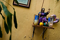 A figurine of Santa Muerte (Saint Death) is seen placed in a temple in the historical center of Mexico City, Mexico, 1 June 2011. The religious cult of Santa Muerte is a syncretic fusion of Aztec death worship rituals and Catholic beliefs. Born in lower-class neighborhoods of Mexico City, it has always been closely associated with crime. In the past decades, original Santa Muerte's followers (such as prostitutes, pickpockets and street drug traffickers) have merged with thousands of ordinary Mexican Catholics. The Saint Death veneration, offering a spiritual way out of hardship in the modern society, has rapidly expanded. Although the Catholic Church considers the Santa Muerte's followers as devil worshippers, on the first day of every month, crowds of believers in Saint Death fill the streets of Tepito. Holding skeletal figurines of Holy Death clothed in a long robe, they pray for power healing, protection and favors and make petitions to 'La Santísima Muerte', who reputedly can make life-saving miracles.