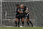 28 August 2009: Central Florida's Courtney Whidden (center) celebrates her second goal with Yvonne George (left) and Nicolette Rodovcic (right). The Duke University Blue Devils lost 3-2 to the University of Central Florida Knights at Fetzer Field in Chapel Hill, North Carolina in an NCAA Division I Women's college soccer game.