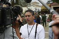 Monday December 8, 2008:  University City, San Diego California.  Freelance Photographer Sandy Huffaker speaks to the media at the scene of a military jet crash near his home that killed four people on the ground.  At approximately 11:59am a USMC F-18 fighter jet encountered trouble over this residential area of the city and the pilot ejected leaving his aircraft to crash into a residential neighborhood.