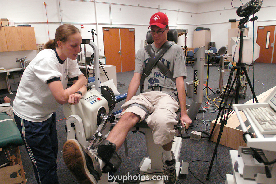 Mandy Woolstenhulme (mw@email.byu.edu) directs a biomechanics test on Anton Kuhlman (lamebord@yahoo.com)...Aug. 22, 2004.Day in the life of BYU..Photo by Steve Walters/BYU