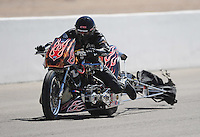 Mar. 31, 2012; Las Vegas, NV, USA: NHRA top fuel Harley motorcycle rider Doug XXXX has his chute tangled in the wheeliebar during qualifying for the Summitracing.com Nationals at The Strip in Las Vegas. Mandatory Credit: Mark J. Rebilas-